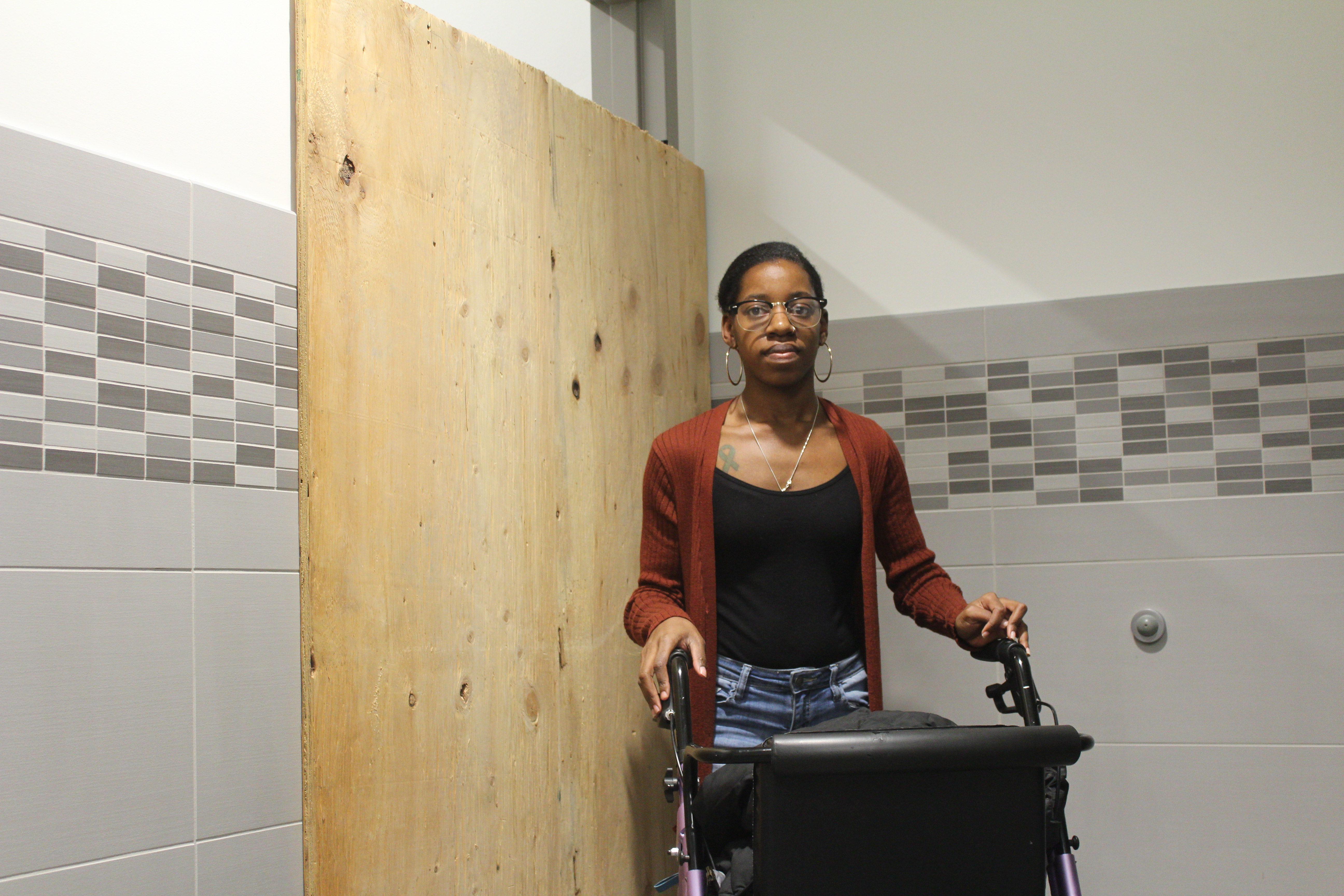 Woman with walker by ADA bathroom
