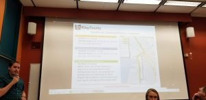 Pic of King County Metro representative discussing slide showing alternate bus routes for viaduct closure