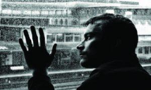 Melancholy-Man-In-Window