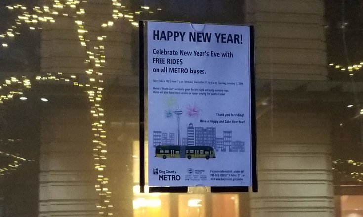 Photo of King County Metro's sign posted inside bus announcing free rides on NYE