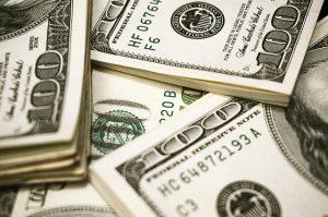 close up of stacks of hundred dollar bills