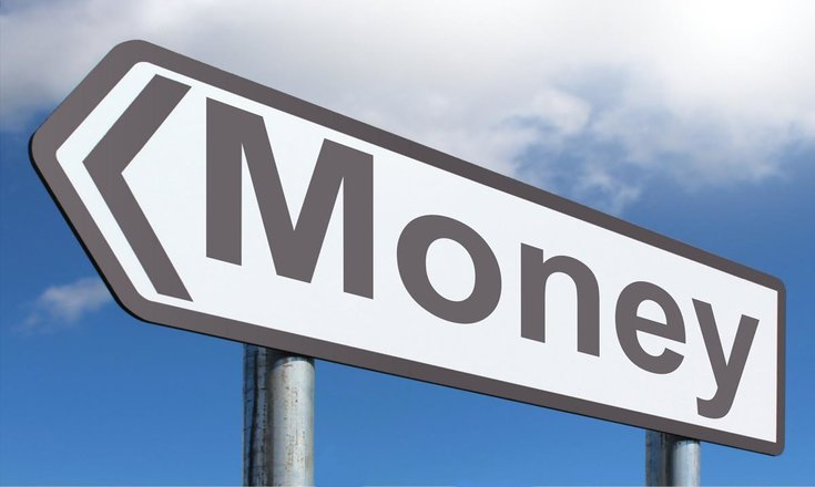 close-up of directional street sign that says 'money'