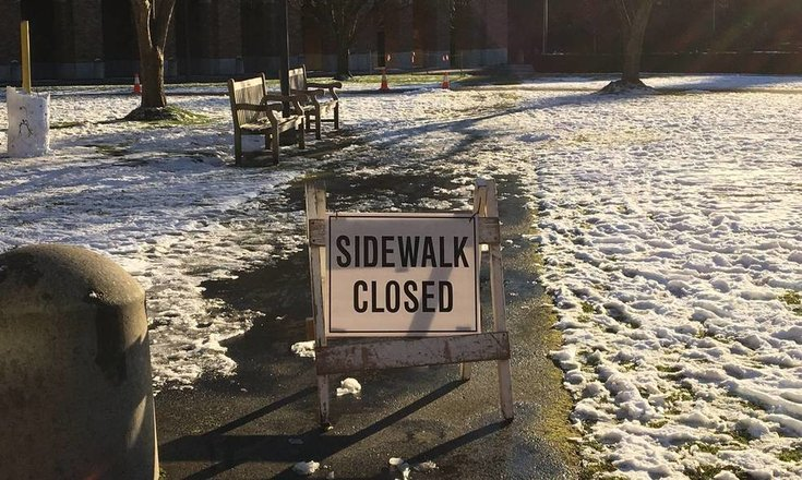 picture of closed sidewalk sign on UW campus near where site of accident