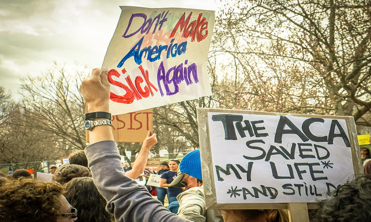 """protest signage """"don't make america sick again"""" and """"the ACA saved my life"""""""