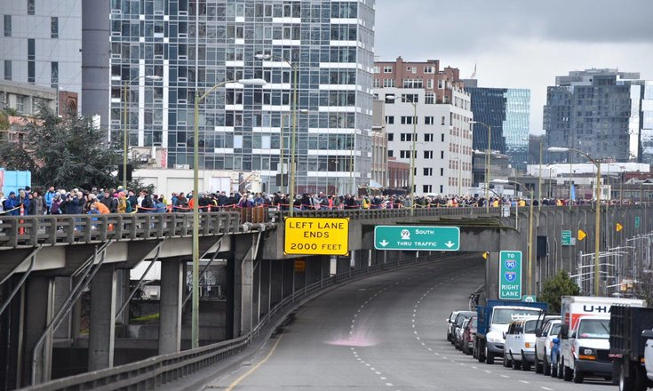 View of people on the viaduct for the grand opening with tunnel entrance looming below