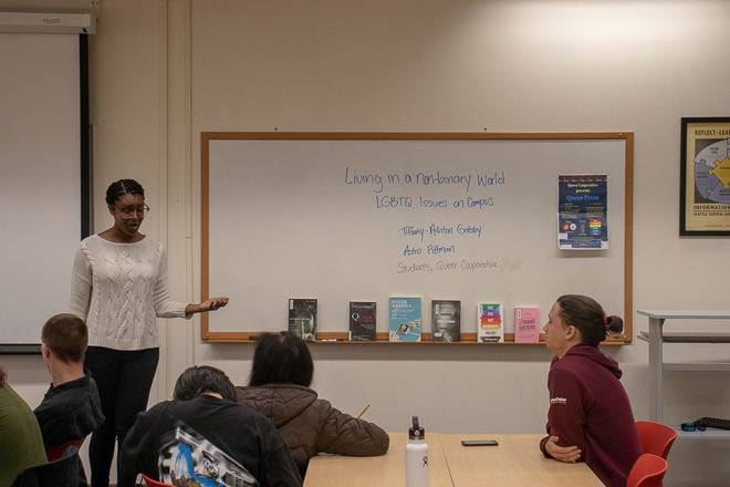 """Kimberly Tate Malone introducing Gatsby & Pittman - on the board behind them is written """"Living in a Non-binary World - LGBTQ+ issues on campus"""""""