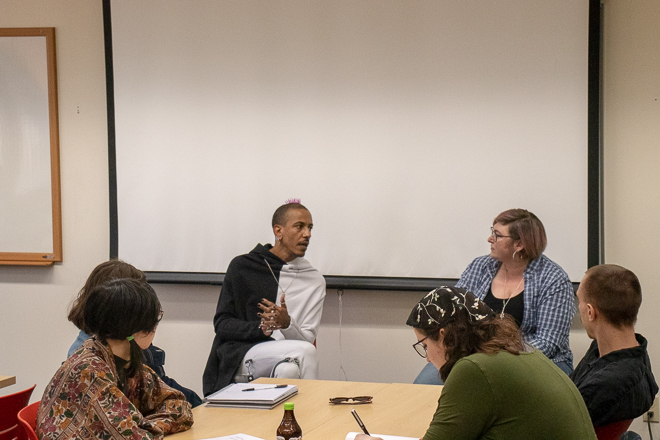 Left, Astro Pittman, Right, Tiffany-Ashton Gatsby - Sitting in front of group discussing LGBTQ issues