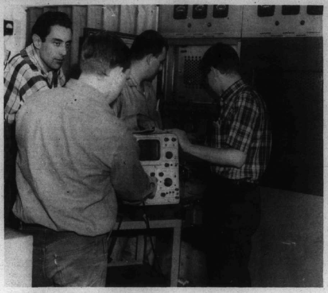 Students working of the old Channel 9 transmitter. From left, Jim Contantine, Jim Steendahl, Jerry Croslin, Ron Blassnig.—Photo by Alvin Thorknlonn.